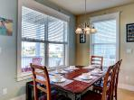 Dining area. Upscale hardwood furnishings. The table on the deck also seats 6.