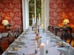 Dining room with doors leading into the orangery home to a 200 year old Camellia tree.