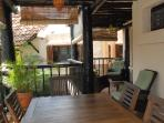 back terrace with Wood dinning room and gas grill