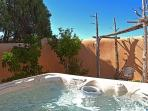 Private hot tub, adobe wall enclosed, offers starry night skies and easy conversation. A gate allows access from other...