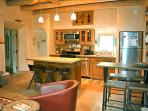 Efficient gourmet kitchen with upscale stainless appliances