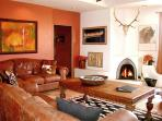 Wood burning Kiva Fireplace and traditional viga ceilings for authentic southwest ambiance