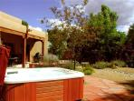 Hot tub in large professionally landscaped enclosed yard