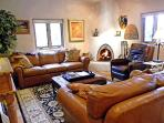 Leather sofas, wood burning Kiva fireplace
