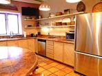 Upgraded stainless dishwasher / fridge & original viga ceilings