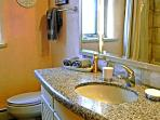 Guest bathroom granite counter and tub/shower combination