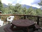 View from hot tub to mountains and patio dining table