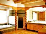Sunken tub / Separate walk-in shower, His and Her's sinks & vanities