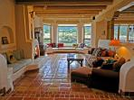 Sunken living room, bay window mountain views, wood burning kiva fireplace