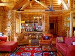 Authentic cedar log ambiance and upscale furnishings throughout
