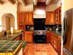 Gourmet kitchen, Wolf oven/range, stainless fridge, custom cherry cabinets