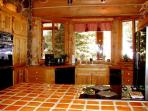 Large gourmet country kitchen with cook stove island and built in double ovens