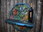 A dependable patio shelf to hold beverage of choice and appropriate glasses or mugs