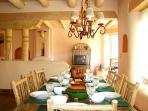 Beautifully set dining table looking toward living room