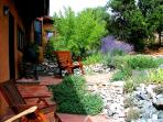 East facing patio for outdoor dining is landscaped with artful rock gardens and native southwest foilage