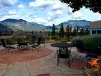 Dramatic sweeping mountain view across huge flagstone patio