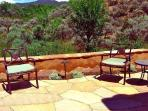 Flagstone patio offers beautiful sun rise views and comfortably shaded evening meals