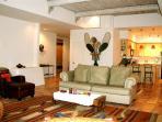 Open floor plan showing living room looking to foyer & kitchen