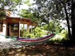 'Lazy days' hammock in lush trees with mountain views of course