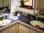 Master bath double sinks in addition to walk in custom talavera tiled shower