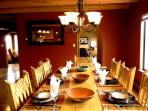 Large dining table with Taos mountain views & ample seating for 8