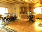 Large dining area with large view windows - beautiful hardwood floors throughout
