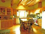 Custom designed kitchen boasting custom crafted hand made cabinets