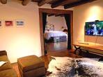 Large master suite with den sleeping for 2 children, big flat screen TV & kiva fireplace + kiva in den (not shown)