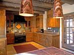 Ultra modern gourmet kitchen with Wolf oven/range