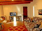 Flat screen satellite TV plus 'Candle only' traditional kiva fireplace for romantic ambiance and warmth