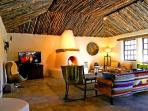 Large living room, 20 foot Aspen latilla ceilings, giant kiva fireplace, extraordinary rustic contemporary furnishings