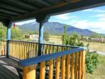 Panoramic view of Taos Mountain from studio covered deck - interior photos to follow