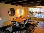 Sunken formal dining room surrounded by windows plus kiva for fireside dining