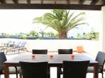 Relaxed dining under the pergola, with views to the sea