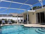 Large Heated Pool with Lounge Chairs and a Table. Plenty of Space for Entertaining.