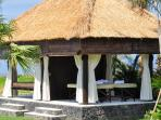 Relaxation pavilion on the beach with large, comfortable daybed and massage corner