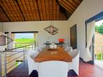 2nd floor: upper dining room with panoramic view over rice fields, mountains and ocean