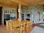 Built-in table with ample seating in kitchen with fireplace.  Grill located on front deck.