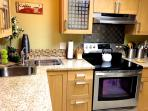 Updated kitchen with all stainless steel appliances and granite counter