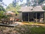Backyard with large deck and screened porch.