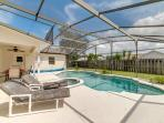 Pool, sunloungers and lawn beyond