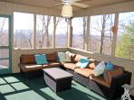 Screened porch with sectional,  table and ceiling fan. Adjoins deck/kitchen.