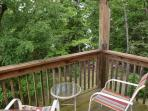 Beautiful wooded view off the master bedroom deck.