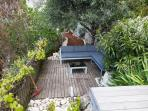 Salon de jardin vu depuis la terrasse garden furniture seen from the terrace