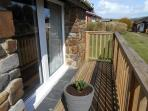Side decking of lodge, lodge is stone and wood built.
