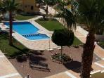 View of the communal swimming pool from the rooftop solarium