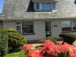 A few minutes walk to the beach centre of Morfa Nefyn with parking and sunny garden newly decorated