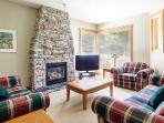 The living area had large windows, comfy furniture and a large feature fireplace