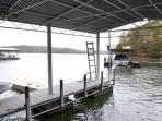 Single slip dock on deep water with collapsible steps attached.
