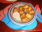 Our famous conch fritter at our famous Fish Fry - walking distance from apartment